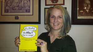 This is Julie, holding the first copy I signed!
